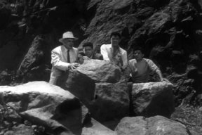 Hiding behind rock