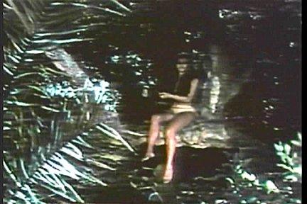 Savage woman in tree
